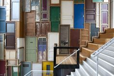 artwork, made out of a collection of old doors, by designer Piet Hein Eek