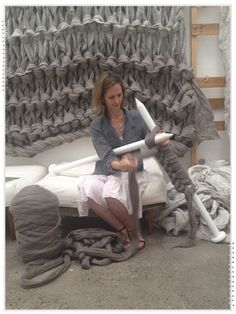 Jacqueline Fink knitting one of her giant blanket installations