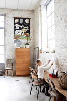 exposed brick + seating against wall.