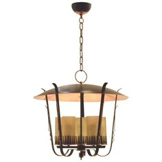 Art Deco Ornamentalist Black and Copper Chandelier Lantern, 1940    From a unique collection of antique and modern lanterns at https://www.1stdibs.com/furniture/lighting/lanterns/