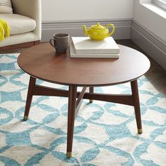 "Reeve Mid-Century Coffee Table - Walnut | West Elm, on sale $319, regular price $399; 30""diam. x 18.5""h."