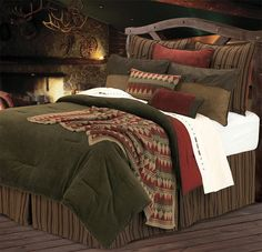 Rich colors of green, red and brown make up this Wilderness Ridge log cabin bedding.- Cabin Decor
