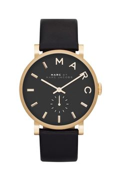 This elegant black and gold watch has a polished and classic look making it the fave accessory for everyday wear. / @nordstrom