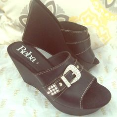 Ladies designer shoes Black Wedge with Buckle. Never wore these shoes but they were too cute to pass up but I have yet to use them Reba Shoes