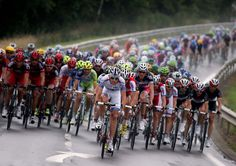 The pack rides in the rain during the fourth stage of the Tour de France cycling race over 214.5 kilometers (133.3 miles) with start in Abbeville and finish in Rouen, France, Wednesday July 4, 2012. (AP Photo/Christophe Ena)