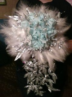 Light blue roses, crystal flowers and white feathers bridal cascading bouquet