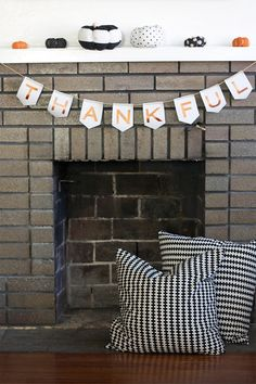 A DIY leather bunting with shimmering metallic letters.