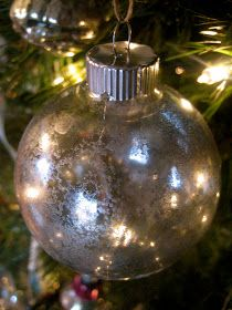 "DIY Mercury Glass(esque) Ornaments -- (1) Spray with ""KRYLON Looking Glass mirror-like Paint""  (2) Squirt with water. (3) Hang to dry"