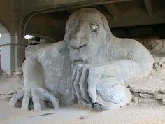 The Fremont troll....took up residence under the north end of the Aurora bridge on Halloween 1990, and hasn't left since. He was sculpted by four Seattle area artists -- Steve Badanes, Will Martin, Donna Walter and Ross Whitehead -- for the Fremont Arts Council. The head-and-shoulders sculpture is 18-ft. tall.