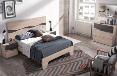Dormitorio con comoda