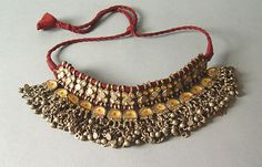 An antique katesari silver choker from Uttar Pradesh (India). tikka: a red dot painted at the center of each one of the pendants, set with clear glass over a golden colored foil. India Jewelry, Tribal Jewelry, Bohemian Jewelry, Silver Choker, Silver Necklaces, Silver Jewelry, Silver Rings, Antique Jewelry, Vintage Jewelry