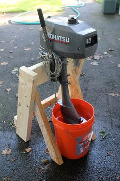 For a number of years, I used a piece of 2x4 screwed to the side of the garden shed as a mount for my 3.5hp Tohatsu outboard. It would perch happily thereon while I dangled its nether regions in a cooling tub of fresh water, sputtering and burbling away as the salt got rinsed from its innards. This year, I decided something more sophisticated was in order for my faithful motor. I wanted a
