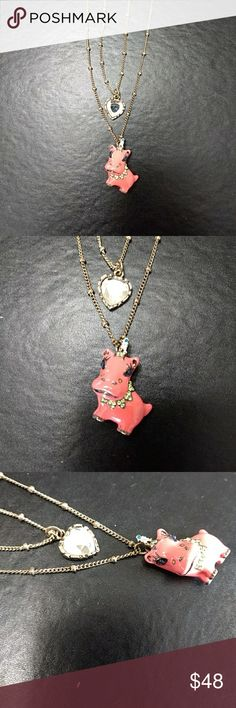 Betsey Johnson pink hippo necklace Gold tone necklace has heart shaped rhinestone charm and pink hippopotamus with a unicorn horn, accented with green and clear rhinestones. Betsey Johnson Jewelry Necklaces