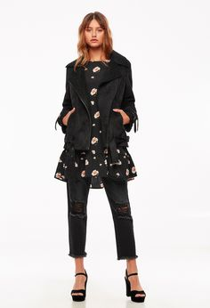 Flower print dress paired with a black jacket from the CASTRO Jeans Symphony collection