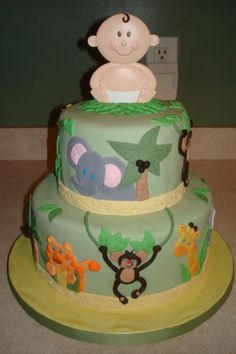 Jungle baby cake... personally I say no baby topper.. but super cute!