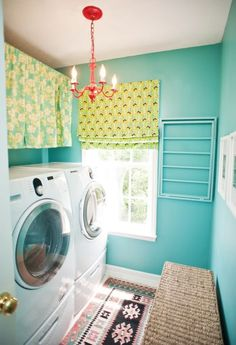 Emily & Todd's laundry room from Little Green Notebook... what a great wall color (Peacock Blue by Benjamin Moore)! Love the curtains to hide shelves, too