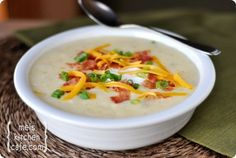 Loaded Baked Potato Soup - 4-5 medium russet baking potatoes  4 tablespoons butter  1/2 cup all-purpose flour, divided  6 cups milk  2 teaspoons salt  1/4 teaspoon ground black pepper  3/4 cup shredded sharp cheddar cheese  1/3 cup finely diced green onions  1/3 cup light sour cream