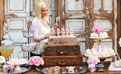 Vintage dessert table with suitcases. Parisian baby shower ideas!