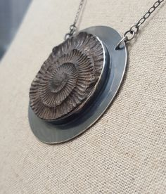 Check out this item in my Etsy shop https://www.etsy.com/uk/listing/266140478/whitby-relief-ammonite-fossil-pendant