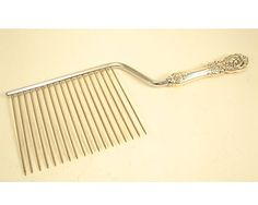 This comb-like cake server was designed for egg-white cakes like Angel Food. Using a traditional, solid server would squash these delicate pastries whereas the tines in the cake breaker would cut through cleanly.  Reed & Barton Francis I Sterling Cake Breaker, 10–11'' length; sold for $30.