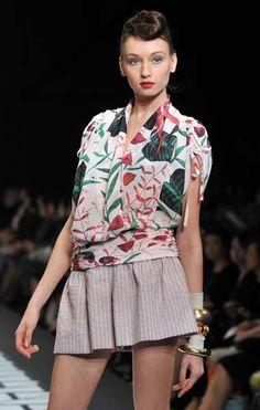 A model displays a flower printed dress by Japanese designer Tae Ashida