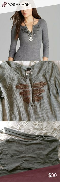 "We The Free gray thermal bronze military embellish We The Free gray long sleeve thermal with bronze military inspired bib. Size small. Cotton, polyester, rayon blend. Gently used with no flaws.  Flat Lay Bust: 14"" Length: 26"" Free People Tops Tees - Long Sleeve"