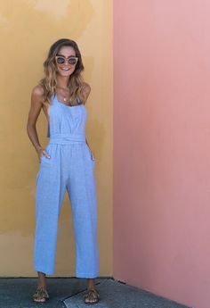Cute jumpsuit. Shirt perhaps? Nautical striped, elbow length sleeves, fitted, boat necked tee. High neck, puffed short sleeve, white button down. Blank tank top.