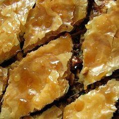 Baklava Recipe Desserts with ground cinnamon, ground allspice, blanched almonds, walnuts, raw pistachios, rose water, phyllo dough, melted butter, honey, water, sugar, cinnamon sticks, orange peel