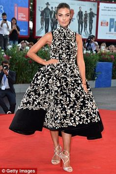 Monochrome magic: Italian modelAlessia Reato looked stunning in a bold black and white evening dress