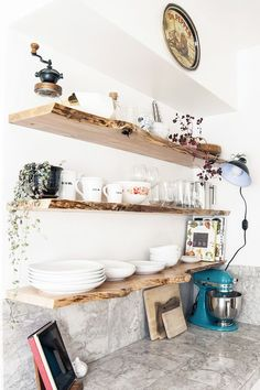 modern kitchen with open raw wood edge shelves