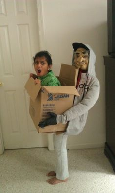 """Trapped in a box Neha Pai, 9, of Fairfax Inspiration: """"I got this idea after researching on the Internet. It is an optical illusion that looks like I am sitting in a box carried by a scary person. So what do you think, am I sitting in the box or am I standing? Who is that scary guy holding me? Beware everyone!"""" Supplies: Box big enough to fit in, clothing for scary guy, including sweat shirt, gloves and mask. Amount of time to make: About three hours. Amount of grown-up …"""