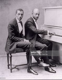 Portrait of American jazz pianist Eubie Blake (R) (1883 - 1983) and singer Noble Sissle (1889 - 1975) seated at the piano, circa 1920.