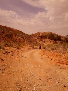 my daughter hiking in the desert with her rocker jeans and a purple shirt