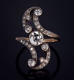 A Belle Epoque Antique Diamond Swirl Ring, European, circa with French import marks. The ring is silver over gold, set with 30 old cut diamonds; the center stone is a cushion cut diamond. Edwardian Jewelry, Antique Jewelry, Silver Jewelry, Vintage Jewelry, Silver Ring, Jewlery, Bijoux Art Nouveau, Art Nouveau Jewelry, Jewelry Gifts