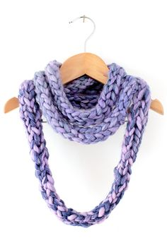 A finger knit infinity scarf, is a practical, easy first project to try and makes a great gift! Finger knitting is also a great introduction to knitting!