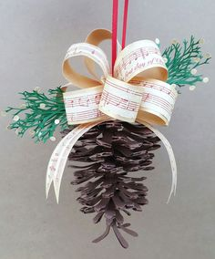 Paper Pinecone ornament. The entire thing is made out of paper! The cutting file and instructions are in the link. The pinecone looks so real!
