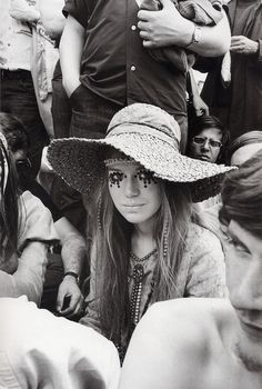 rolling stones concert, note the eyes, girls painted flowers, peace signs, all kinds of friendly items on their faces. Ah- those 60's were something.