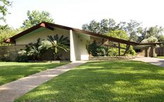 Houston Mid-Century Modern Home.  Love the redwood beams and light turquoise eaves.