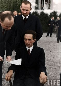Alfred Eisenstaedt's famous photo of Joseph Goebbels for LIFE Magazine taken at the League of Nations conference in Geneva; September 1933. The malevolent stare is all too visible. It never left Goebbels. I guess he died viewing the world like this. Colorized by British artist, Paul Edwards