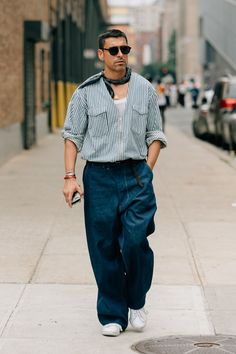 The best men's street style fits spotted outside the New York Fashion Week: Men's Spring-Summer 2018 shows by the editors, buyers, and more who wear them best.