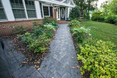 Client wanted to improve front yard with a new driveway and walkway. We used Outdoor Living by Belgard Laffit paver in Sable blend with Old World Mega border in Sable for the driveway and walkway. Looking forward to Phase 2! After photos by Matchbook Productions.
