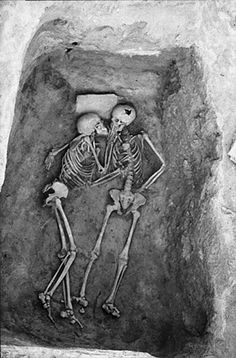 A 6,000 year-old kiss.  Hasanlu is an archaeological excavation site in Iran, Western Azerbaijan, Solduz Valley. Theses skeletons were found in a Bin with no objects. The only feature is a stone slab under the head of the skeleton on the left hand side.