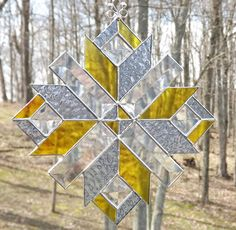 Stained Glass Quilt Star Suncatcher  Blue Yellow. $30.00, via Etsy.