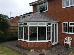 Transform your conservatory with a Tiled Roof Replacement from Abbey & Burton Glass. Warm Roof, Roofing Systems, Conservatory, Glass, Outdoor Decor, Home Decor, Decoration Home, Drinkware, Room Decor