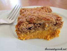 PUMPKIN DUMP CAKE  1 (15 0z.) can pumpkin,  1 can evaporated milk,  3 large eggs,  1C sugar,  1t cinnamon,  1 box Spice Cake Mix,  1C butter, melted.  :Preheat oven to 350. grease 9x13 pan. combine pumpkin, milk, eggs, sugar and cinnamon.  Pour into pan. Sprinkle dry cake mix on top, drizzle with melted butter.  Bake 55-60 min. Cool for 30.