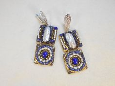 Check out this item in my Etsy shop https://www.etsy.com/listing/266226009/two-tier-earrings-encrusted-with