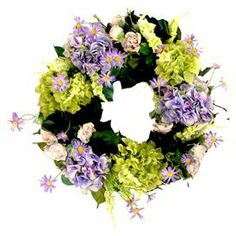"""Bring a garden-fresh touch to your front door or master suite wall with this beautiful wreath, showcasing an array of delightful faux hydrangea and wildflowers.   Product: Faux floral wreathConstruction Material: Silk, polyester, grapevine and burlap ribbonColor: Purple, green and pinkFeatures: Includes faux hydrangeas and wildflowersDimensions: 24"""" DiameterCleaning and Care: For indoor Use Only"""