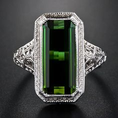 : Tourmaline filigree ring, 1930s. Via Diamonds in the Library.