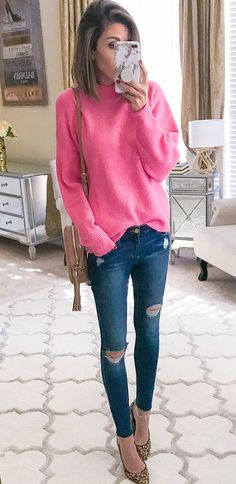 #winter #outfits pink sweater with distressed blue denim skinny jeans