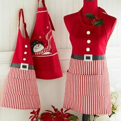 Holiday Candy Stripe Santa Apron - cotton bib apron with pockets;Applique belt with dimensional flocked faux buttons Link Christmas Aprons, Christmas Sewing, Sewing Aprons, Sewing Clothes, Cool Aprons, Bib Apron, Apron Dress, Aprons Vintage, Retro Apron
